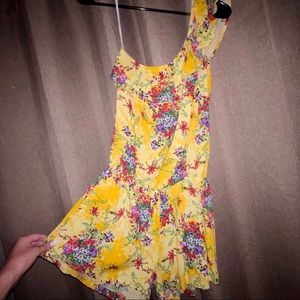 One shoulder yellow floral ruffle romper